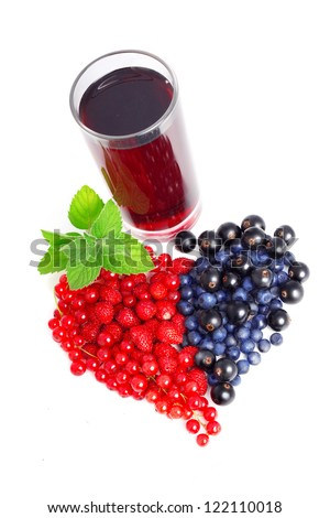 Glass of fresh juice and berries