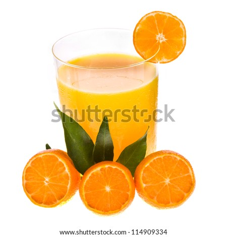 glass of fresh juice from the mandarin, decorated with cut in fruits with leaves isolated on white background - stock photo