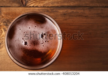 glass of fresh lager beer ..view from above. - stock photo