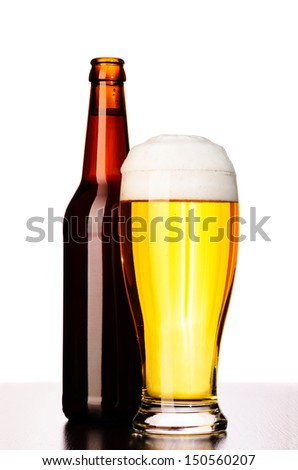 glass of fresh lager beer with bottle cut out from white