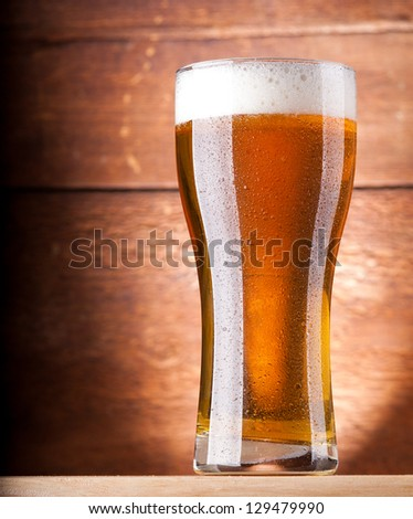 glass of fresh light beer - stock photo