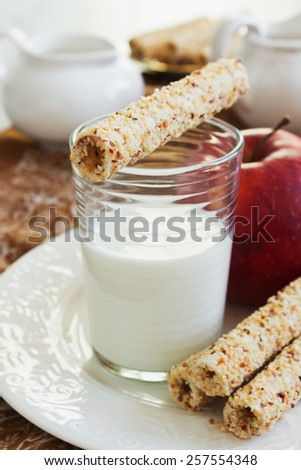 glass of fresh milk, cookies and ripe apple on the table. healthy breakfast.selective focus - stock photo