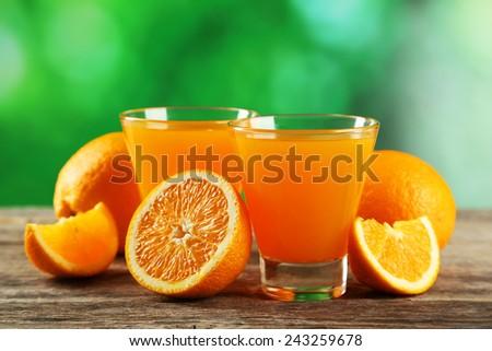 Glass of fresh orange juice on grey wooden background - stock photo