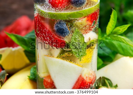 Glass of fresh strawberry detox water with fruit - stock photo