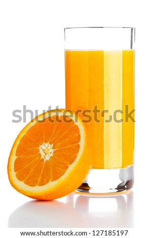 Glass of freshly pressed orange juice with sliced orange half over white background