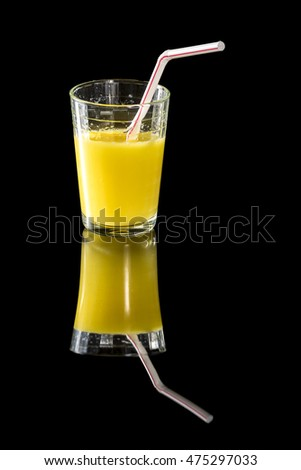 Glass of fruit juice with a straw in it