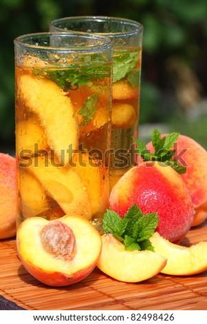 Glass of fruity ice tea. - stock photo