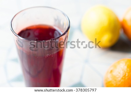 Glass of Grape and Orange Juice on the Table, Close-up