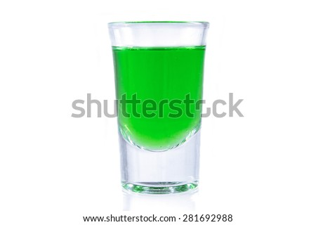 Glass of green absinthe - stock photo