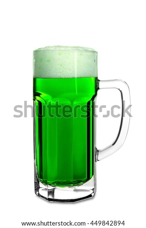 Glass of green beer with handle on white background