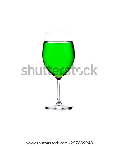 glass of green lemonade isolated on white background