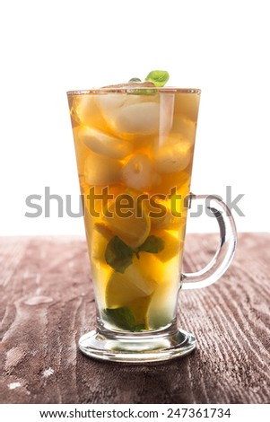 Glass of ice tea with lemon and mint - stock photo