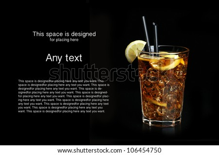 glass of ice tea with lemon on black background - stock photo