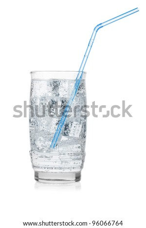 Glass of iced mineral water with straw isolated on white. - stock photo
