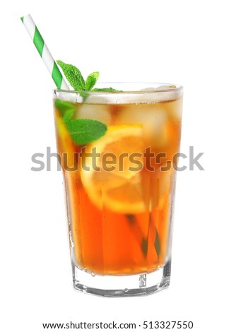 Glass of iced tea with lemon slices and mint on white background