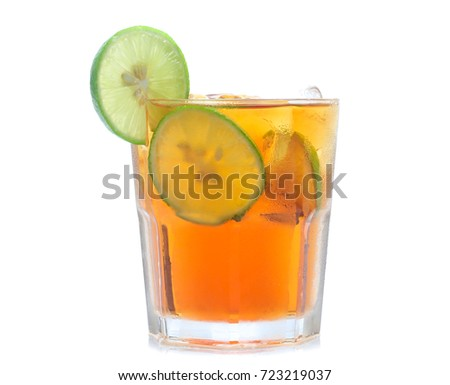 glass of iced tea with lemons  isolated on a white background