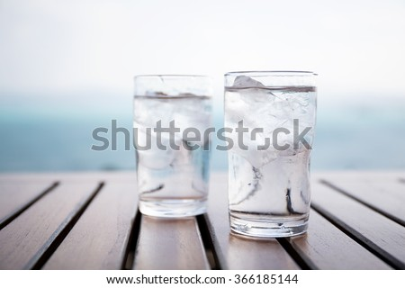 Glass of iced water at restaurant - stock photo