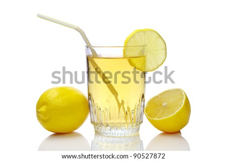 Glass of juice and lemons on a white background