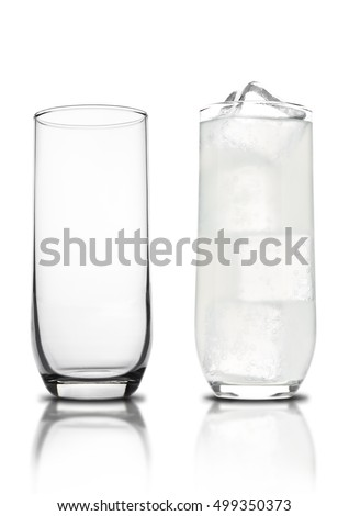 Glass of lemon lemonade with ice cubes empty glass and bubbles with reflection on white background