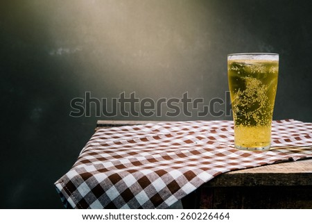 Glass of light beer - stock photo