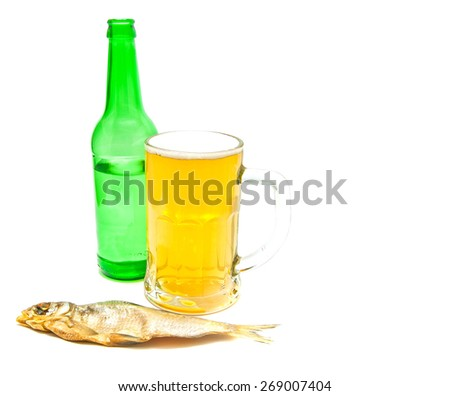 glass of light beer and stockfish on white