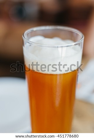 Glass of light Beer in Restaurant