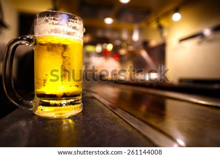 Glass of light beer on a restaurant - stock photo