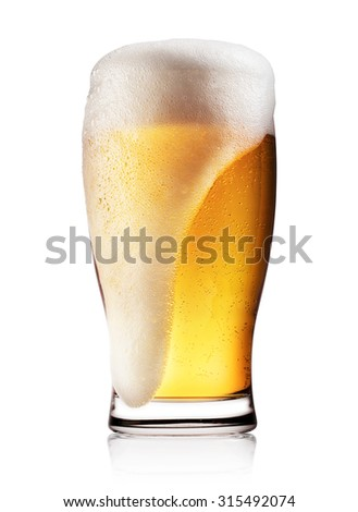 Glass of light beer with white foam isolated on white background