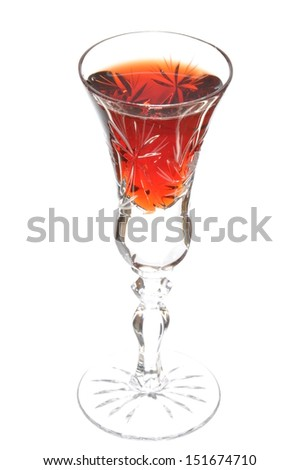 Glass of liqueur isolated on white background - stock photo