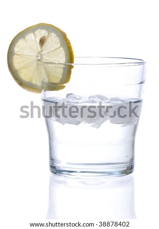 glass of liquid with lemon isolated over a withe background