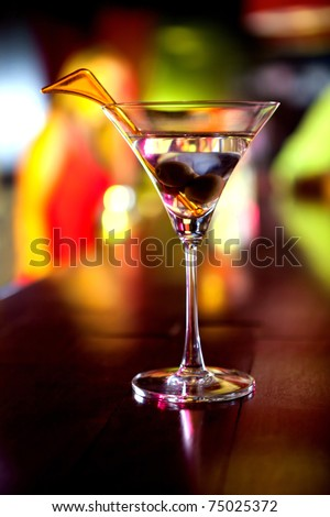 Glass of martini drink with olives at the bar ? cocktail concepts - stock photo