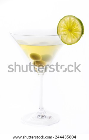Glass of martini with olive and lime isolated on white - stock photo
