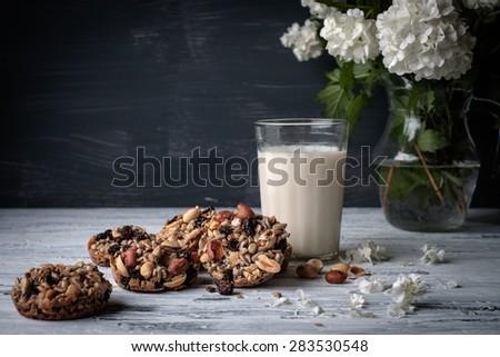Glass of milk and cookies made of nuts and raisins. Kozinaki. - stock photo