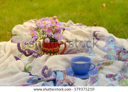 Glass of milk and flowers - stock photo