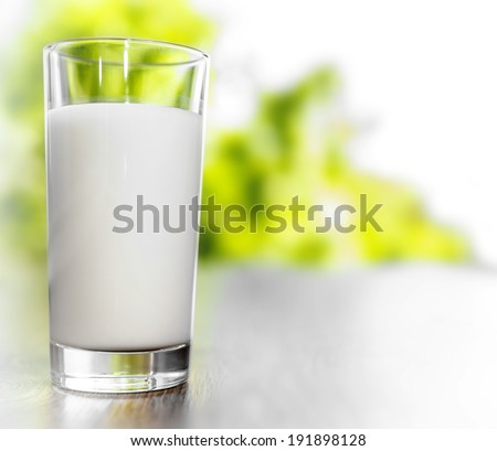 Glass of milk on a nature background  - stock photo