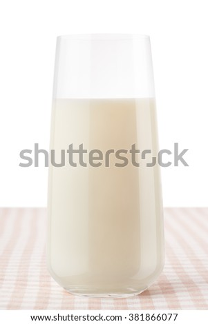 Glass of milk on classic brown and white checkered tablecloth, isolated on white background, including clipping path