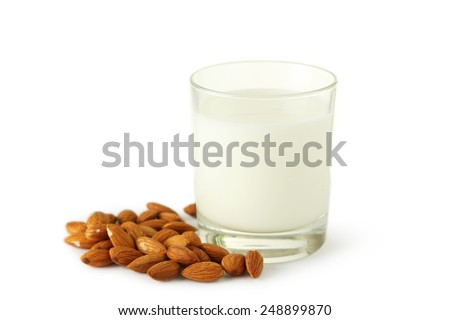 Glass of milk with almonds isolated on white - stock photo