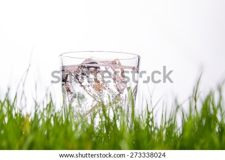 glass of mineral water with ice - stock photo