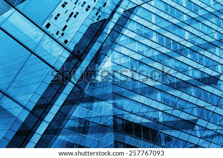 Glass of modern tower for business background, blue tone