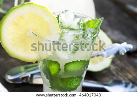 glass of mojito on wooden background