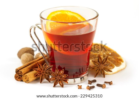 glass of mulled wine and spices on white background - stock photo