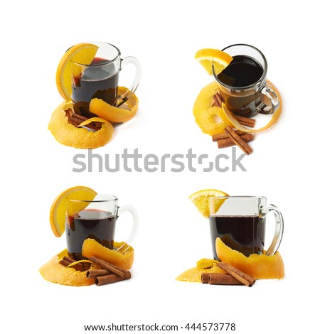 Glass of mulled wine decorated with the cinnamon sticks, peels and slice of orange, composition isolated over the white background, set of four different foreshortenings - stock photo
