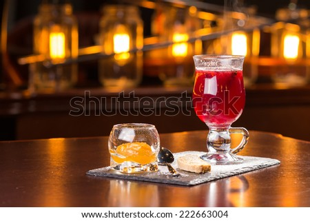 Glass of mulled wine on the bar - stock photo