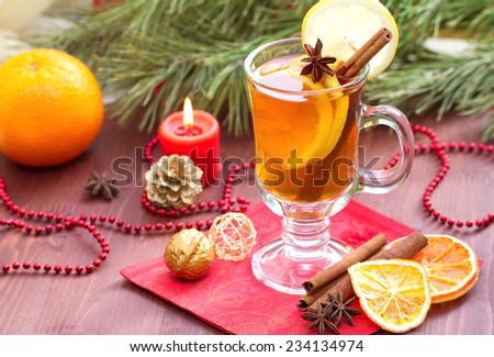 Glass of mulled wine with christmas decoration
