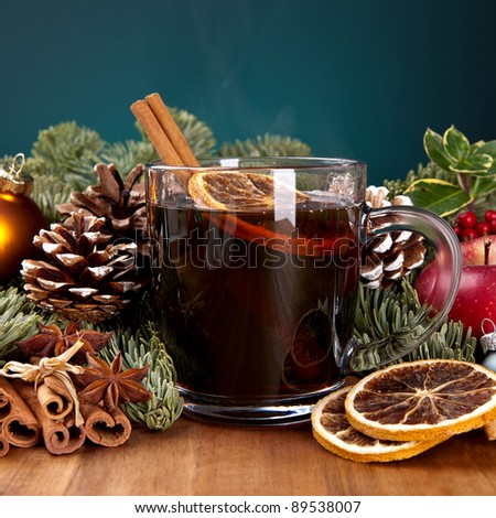 glass of mulled wine with cinnamon, lemon and anise - stock photo