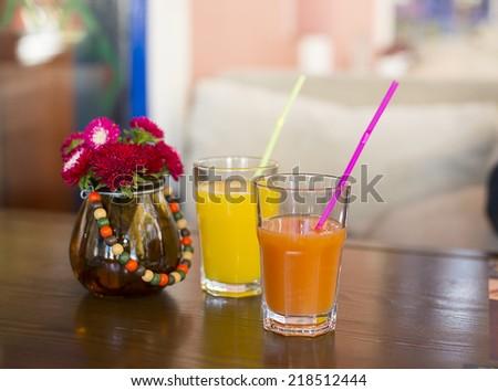 glass of multivitamin juice - stock photo