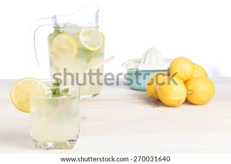Glass of natural lemonade just squeezed on wooden table