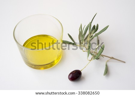 glass of oil and olive branch