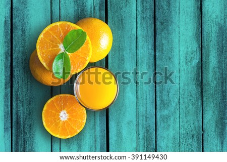 Glass of orange juice from above on vintage wood table. - stock photo
