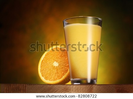 Glass of orange juice on a wooden board. - stock photo